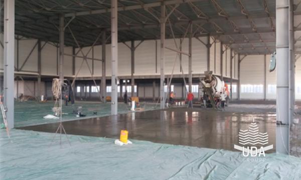 промышленный бетонный пол топпинг портфолио строительной компании ЮДА групп